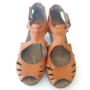 Merrell. Comfy fit sandals with heels.